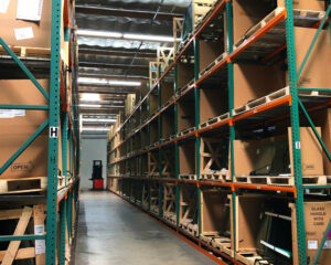 A view of The AGS warehouse featuring a selection of auto glass options for popular vehicles